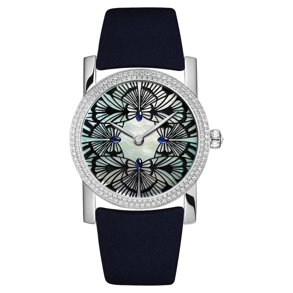 Butterflies with heads made of cabochon sapphires are rendered in China ink in this timepiece from Chaumet's Montres Precieuses line.