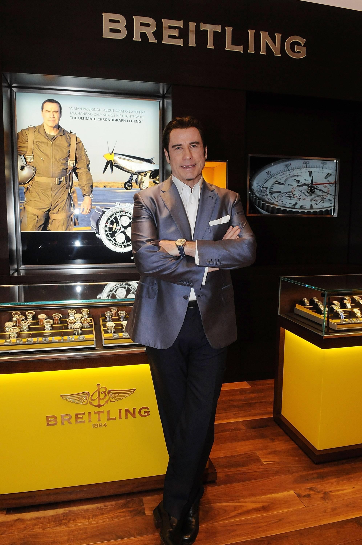 John travolta helps breitling open new boutique in orlando best luxury watch brands patek for John travolta breitling