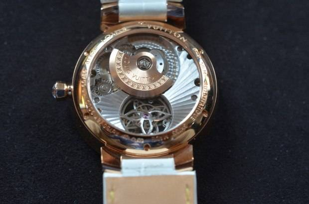 The micro rotor of the Tambour Monogram Tourbillon is placed where it cannot block the view of the tourbillon cage.