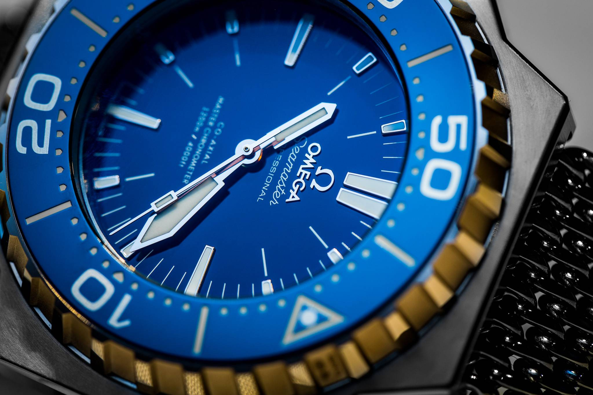 Replica Omega Seamaster Ploprof 1200M Master Chronometer Co-Axial Blue Dial Close Up