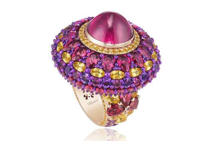 Red Carpet Ring in 18ct rose gold and titanium featuring a 9.6cts rubellite cabochon and set with fancy-cut rubellites (12.2cts), fancy-cut yellow sapphires (5.5cts) and brilliant-cut amethysts (2.6cts)