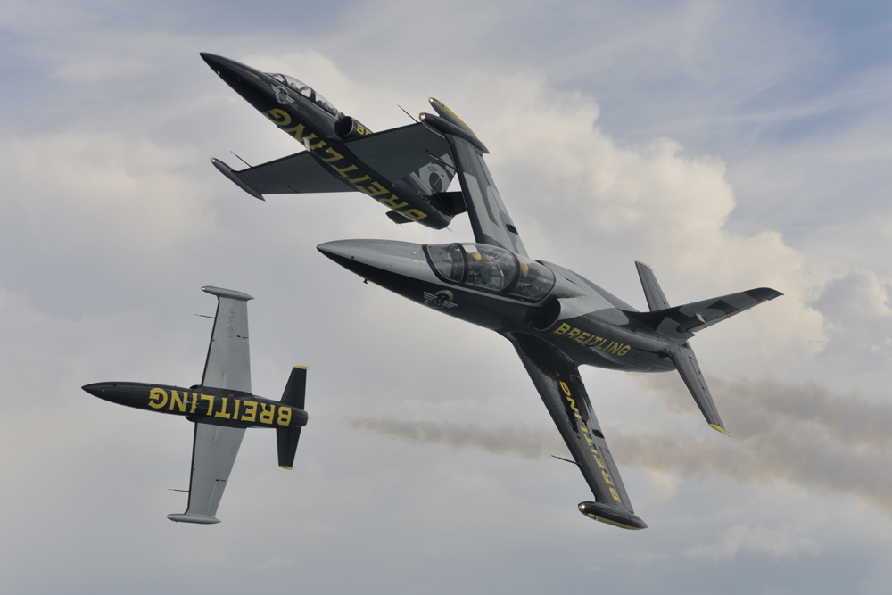 The Breitling Jet Team flies formation and enacts magnificent aerobatic maneuvers.