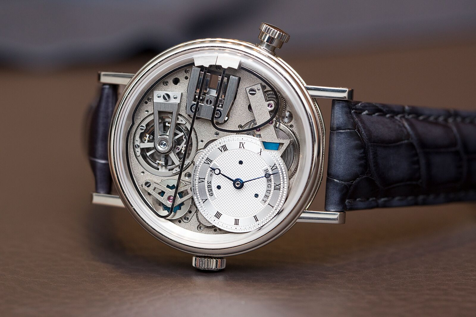 To create a better performing governor Breguet developed one that utilizes magnetism and put it in this stunning Tradition 7078 Minute Repeater Tourbillon. The wire gongs are the two metal wires that start at the three o'clock position and curve around on the front of the watch.