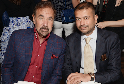 Jorge Pérez and Kamal Hotchandani seated for dinner / Photo Credit: Getty Images for Haute Living