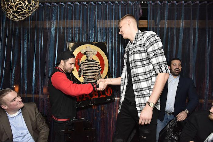 Jojo Anavim and Kristaps Porzingis  (Photo by Eugene Gologursky/Getty Images for Haute Living)