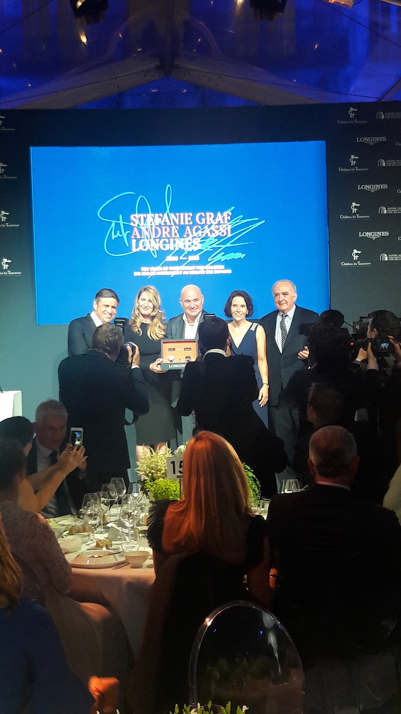 Longines President Walter von Känel and Vice-President Juan Carlos Capelli join the stage to support the charities of Andre Agessi and Stefanie Graf with an exclusive limited edition